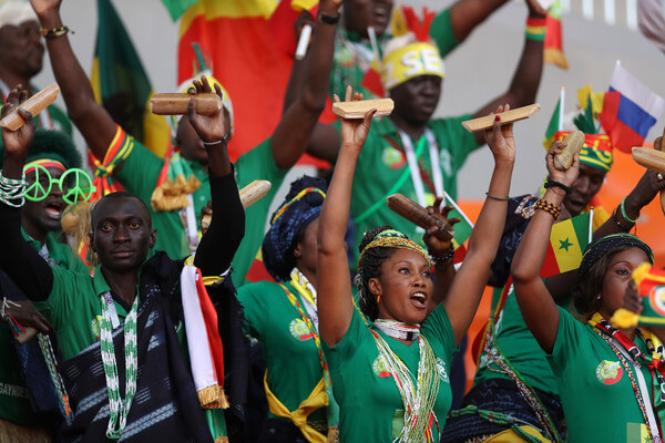 Senegal fans enjoy the pre match atmosphere prior to the 2018 FIFA World Cup Russia group H match between Japan and Senegal at Ekaterinburg Arena on June 24, 2018 in Yekaterinburg, Russia.  (June 23, 2018 - Source: Clive Rose/Getty Images Europe)