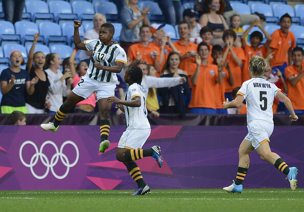Portia Modise of South Africa celebrates scoring during the Women's Football first round Group F Match of the London 2012 Olympic Games between Sweden and South Africa, at City of Coventry Stadium on July 25, 2012 in Coventry, England.  (July 24, 2012 - Source: Sindy Thomas/Getty Images Europe)