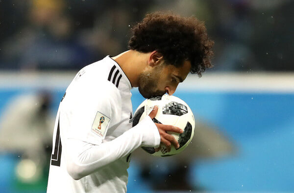 Mohamed Salah of Egypt kisses the ball before scoring from the penalty spot during the 2018 FIFA World Cup Russia group A match between Russia and Egypt at Saint Petersburg Stadium on June 19, 2018 in Saint Petersburg, Russia.  (June 18, 2018 - Source: Francois Nel/Getty Images Europe)