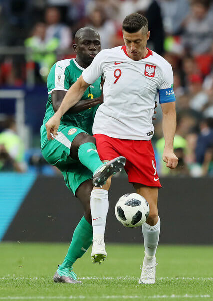 Robert Lewandowski of Poland is challenged by Kalidou Koulibaly of Senegal during the 2018 FIFA World Cup Russia group H match between Poland and Senegal at Spartak Stadium on June 19, 2018 in Moscow, Russia.  (June 18, 2018 - Source: Kevin C. Cox/Getty Images Europe)
