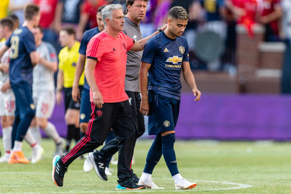 Manager Jose Mourinho consoles Andreas Pereira #15 of Manchester United after the team lost to Liverpool during the International Champions Cup 2018 at Michigan Stadium on July 28, 2018 in Ann Arbor, Michigan. Liverpool defeated Manchester United 4-1.  (July 27, 2018 - Source: Jason Miller/Getty Images North America)