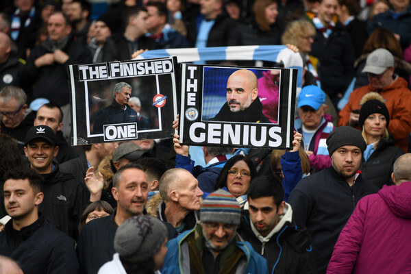 Manchester City fans hold up signs supporting their manager prior to the Premier League match between Manchester City and Manchester United at Etihad Stadium on April 7, 2018 in Manchester, England.  (April 6, 2018 - Source: Michael Regan/Getty Images Europe)