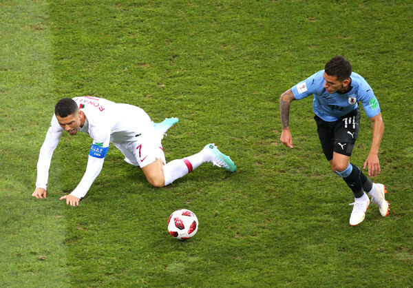 Cristiano Ronaldo of Portugal is challenged by Lucas Torreira of Uruguay during the 2018 FIFA World Cup Russia Round of 16 match between Uruguay and Portugal at Fisht Stadium on June 30, 2018 in Sochi, Russia.  (June 29, 2018 - Source: Alex Livesey/Getty Images Europe)