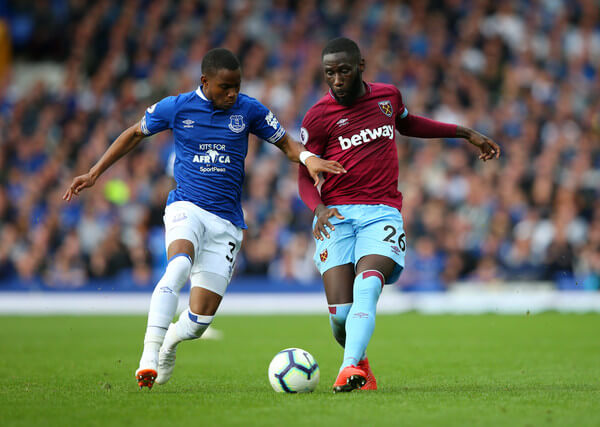 Ademola Lookman of Everton is challenged by Arthur Masuaku of West Ham United during the Premier League match between Everton FC and West Ham United at Goodison Park on September 16, 2018 in Liverpool, United Kingdom.  (Sept. 15, 2018 - Source: Alex Livesey/Getty Images Europe)
