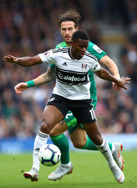Floyd Ayite of Fulham and Daryl Janmaat of Watford in action during the Premier League match between Fulham FC and Watford FC at Craven Cottage on September 22, 2018 in London, United Kingdom.  (Sept. 21, 2018 - Source: Dean Mouhtaropoulos/Getty Images Europe)