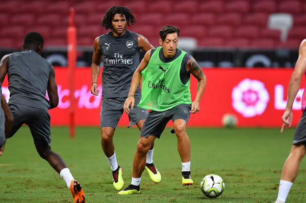 Mesut Ozil #10 and Mohamed Elneny #4 of Arsenal looks on the ball during training ahead of the International Champions Cup 2018 match between Arsenal v Paris Saint Germain on July 27, 2018 in Singapore.  (July 26, 2018 - Source: Thananuwat Srirasant/Getty Images AsiaPac)