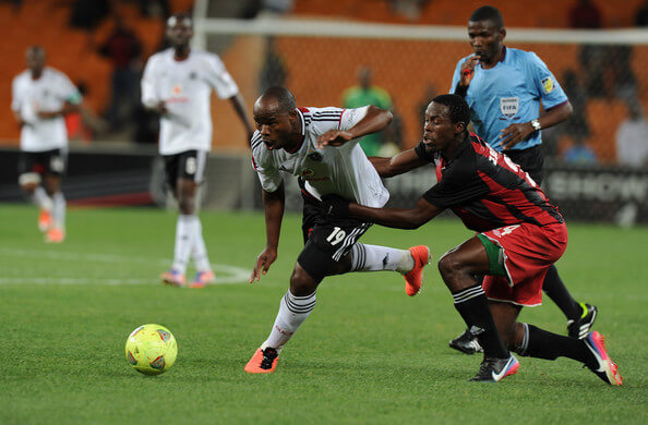 Collins Mbesuma of Orlando pirates battling for the ball with Samson Chilupe of Zanaco FC during the CAF Confedaration Cup match between Orlando Pirates and Zanaco at FNB Stadium on April 06, 2013 in Johannesburg, South Africa.  (April 5, 2013 - Source: Gallo Images/Getty Images Europe)