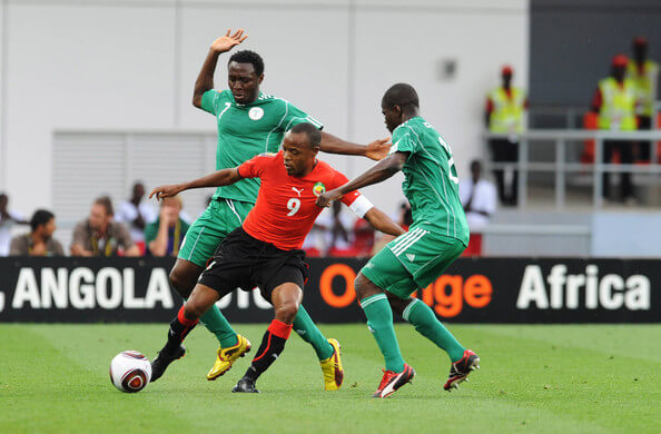 Chinedu Obasi and Obinna Nsofor of Nigeria tackle Tico-Tico Bucuane of Mozambique during the African Nations Cup Group C match between Nigeria and Mozambique, at the Alto da Chela Stadium on January 20, 2010 in Lubango, Angola.  (Jan. 19, 2010 - Source: Gallo Images/Getty Images Europe)