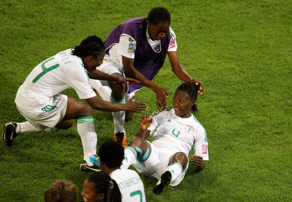 Perpetua Nkwocha of Nigeria celebrates after scoring their first goal during the FIFA Women's World Cup 2011 Group A match between Canada and Nigeria at the Rudolf-Harbig Stadium on July 5, 2011 in Dresden, Germany.  (July 4, 2011 - Source: Scott Heavey/Getty Images Europe)
