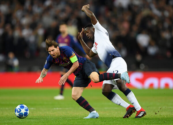 Lionel Messi of Barcelona is tackled by Victor Wanyama of Tottenham Hotspur during the Group B match of the UEFA Champions League between Tottenham Hotspur and FC Barcelona at Wembley Stadium on October 3, 2018 in London, United Kingdom.  (Oct. 2, 2018 - Source: Shaun Botterill/Getty Images Europe)