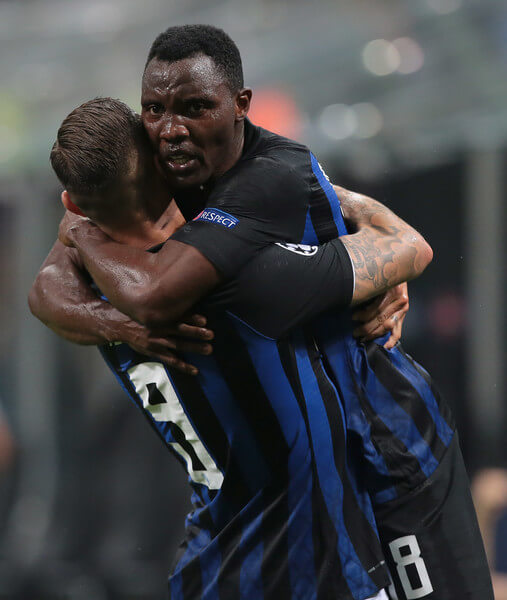Mauro Emanuel Icardi of FC Internazionale celebrates his goal with his team-mate Kwadwo Asamoah (R) during the Group B match of the UEFA Champions League between FC Internazionale and Tottenham Hotspur at San Siro Stadium on September 18, 2018 in Milan, Italy.  (Sept. 17, 2018 - Source: Emilio Andreoli/Getty Images Europe)