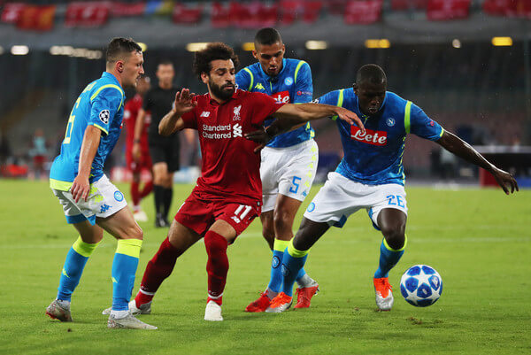 Mohamed Salah of Liverpool battles with Kalidou Koulibaly of Napoli during the Group C match of the UEFA Champions League between SSC Napoli and Liverpool at Stadio San Paolo on October 3, 2018 in Naples, Italy.  (Oct. 2, 2018 - Source: Catherine Ivill/Getty Images Europe)