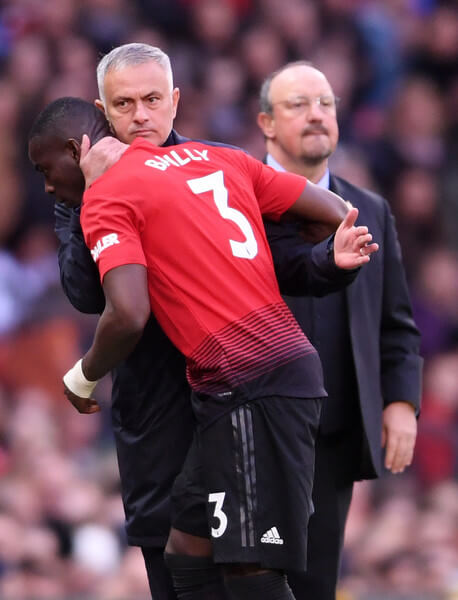 Jose Mourinho, Manager of Manchester United in discussion with Eric Bailly of Manchester United as he is substituted during the Premier League match between Manchester United and Newcastle United at Old Trafford on October 6, 2018 in Manchester, United Kingdom.  (Oct. 5, 2018 - Source: Laurence Griffiths/Getty Images Europe)