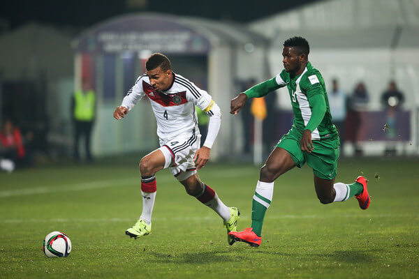 Kevin Akpoguma (L) of Germany battles with Success Isaac (R) of Nigeria during the FIFA U-20 World Cup New Zealand 2015 Round of 16 match between Germany and Nigeria at Christchurch Stadium on June 11, 2015 in Christchurch, New Zealand.  (June 10, 2015 - Source: Martin Hunter/Getty Images AsiaPac)