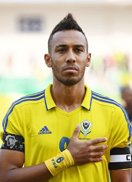Gabon's forward Pierre-Emerick Aubameyang listens to Gabon's national anthem ahead of the 2017 Africa Cup of Nations group A football match between Gabon and Burkina Faso at the Stade de l'Amitie Sino-Gabonaise in Libreville on January 18, 2017. / AFP / GABRIEL BOUYS  (Jan. 17, 2017 - Source: AFP)