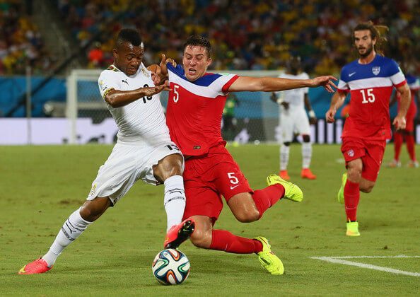 Matt Besler of the United States challenges Jordan Ayew of Ghana during the 2014 FIFA World Cup Brazil Group G match between Ghana and the United States at Estadio das Dunas on June 16, 2014 in Natal, Brazil.  (June 15, 2014 - Source: Kevin C. Cox/Getty Images South America)