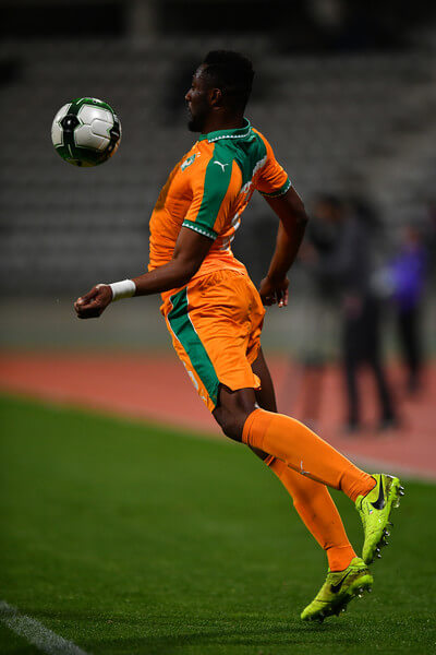 Wilfried Kanon of the Ivory Coast leaps to control the ball during the International Friendly match between the Ivory Coast and Senegal at the Stade Charlety on March 27, 2017 in Paris, France.  (March 26, 2017 - Source: Dan Mullan/Getty Images Europe)