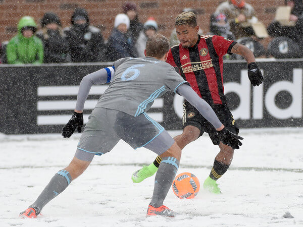 Josef Martinez #7 of Atlanta United FC controls the ball against Vladim Demidov #6 of Minnesota United FC during the second half of the match on March 12, 2017 at TCF Bank Stadium in Minneapolis, Minnesota. Atlanta defeated Minnesota 6-1.  (March 11, 2017 - Source: Hannah Foslien/Getty Images North America)