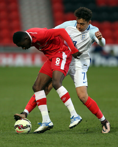 Tyler Walker of England (R) challenges Alphonso Davies of Canada during the U20 International Friendly match between England and Canada at the Keepmoat Stadium on March 27, 2016 in Doncaster, England.  (March 26, 2016 - Source: Nigel Roddis/Getty Images Europe)