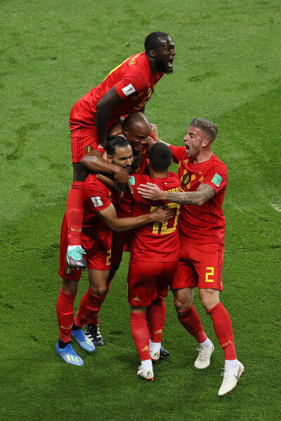 Belgium players celebrate after Fernandinho of Brazil scores an own goal for their sides first goal during the 2018 FIFA World Cup Russia Quarter Final match between Brazil and Belgium at Kazan Arena on July 6, 2018 in Kazan, Russia.  (July 5, 2018 - Source: Kevin C. Cox/Getty Images Europe)