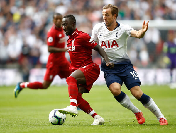 Naby Keita of Liverpool (L) is challenged by Harry Kane of Tottenham Hotspur during the Premier League match between Tottenham Hotspur and Liverpool FC at Wembley Stadium on September 15, 2018 in London, United Kingdom.  (Sept. 14, 2018 - Source: Julian Finney/Getty Images Europe)