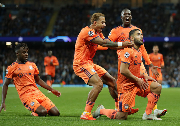 Nabil Fekir of Lyon celebrates after scoring his team's second goal with his team mates during the Group F match of the UEFA Champions League between Manchester City and Olympique Lyonnais at Etihad Stadium on September 19, 2018 in Manchester, United Kingdom.  (Sept. 18, 2018 - Source: Richard Heathcote/Getty Images Europe)
