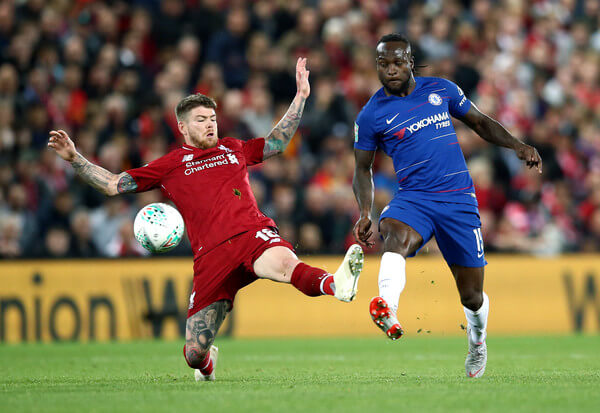 Victor Moses of Chelsea is challenged by Alberto Moreno of Liverpool during the Carabao Cup Third Round match between Liverpool and Chelsea at Anfield on September 26, 2018 in Liverpool, England.  (Sept. 25, 2018 - Source: Getty Images Europe)