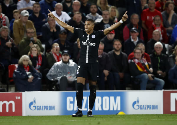Kylian Mbappe of Paris Saint-Germain celebrates after scoring his team's second goal during the Group C match of the UEFA Champions League between Liverpool and Paris Saint-Germain at Anfield on September 18, 2018 in Liverpool, United Kingdom.  (Sept. 17, 2018 - Source: Julian Finney/Getty Images Europe)