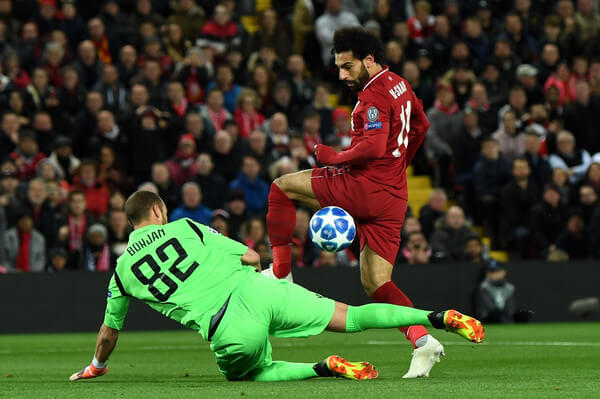 Milan Borjan of FK Crvena Zvezda saves a shot from Mohamed Salah of Liverpool during the Group C match of the UEFA Champions League between Liverpool and FK Crvena Zvezda at Anfield on October 24, 2018 in Liverpool, United Kingdom.  (Oct. 23, 2018 - Source: Michael Regan/Getty Images Europe)