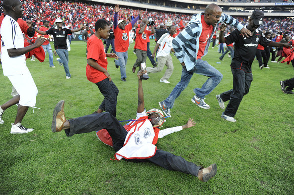 Orlando Pirates fans run onto the field after the Absa Premiership Final match between Orlando Pirates and the Golden Arrows at Orlando Stadium on May 21, 2011 in Soweto, South Africa.  (May 20, 2011 - Source: Gallo Images/Getty Images Europe)