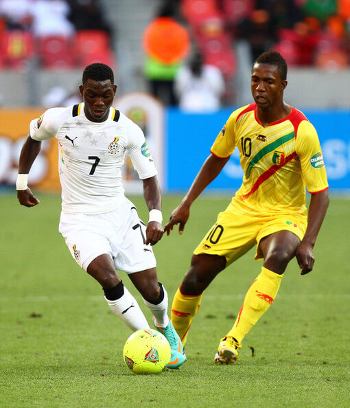 Christian Atsu Twasam of Ghana and Modibo Maiga of Mali during the 2013 African Cup of Nations match between Mali and Ghana at Nelson Mandela Bay Stadium on January 24, 2013 in Port Elizabeth, South Africa.  (Jan. 23, 2013 - Source: Gallo Images/Getty Images Europe)