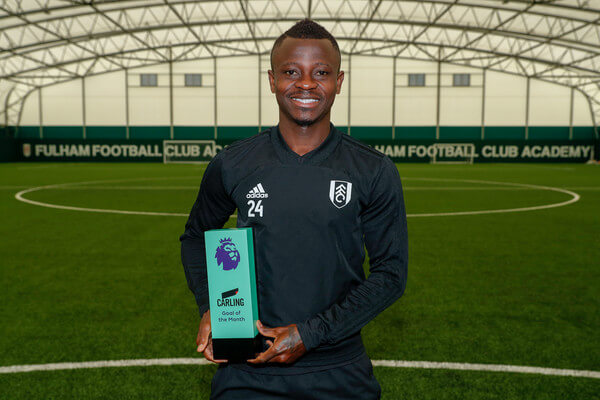Jean Michael Seri poses with the Carling Goal of the Month Award for August 2018 at Fulham FC Training Ground on September 12, 2018 in New Malden, England.  (Sept. 11, 2018 - Source: Getty Images Europe)