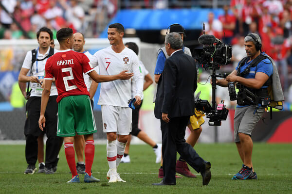 Cristiano Ronaldo of Portugal consoles Achraf Hakimi of Morocco following Morocco's elimination from the World Cup after their defeat in the 2018 FIFA World Cup Russia group B match between Portugal and Morocco at Luzhniki Stadium on June 20, 2018 in Moscow, Russia.  (June 19, 2018 - Source: Stu Forster/Getty Images Europe)