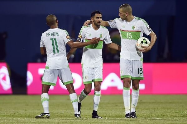 Algeria's forward Riyad Mahrez (C) celebrates with Algeria's midfielder Yacine Brahimi (R) and Algeria's forward Islam Slimani after scoring a second goal during the 2017 Africa Cup of Nations group B football match between Algeria and Zimbabwe in Franceville on January 15, 2017. / AFP / KHALED DESOUKI  (Jan. 14, 2017 - Source: AFP)