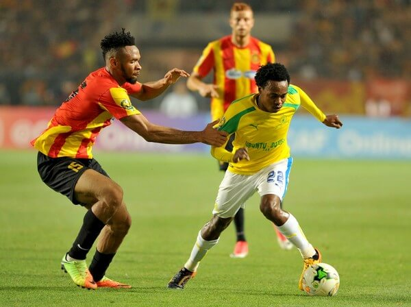 South Africa's Sundowns striker Percy Tau vies with Tunisia's Esperance of Tunis forward Foussiny Coulibaly (L) during the African Champions League (CAF) group stage football match on June 22, 2017 in olympic Rades Stadium near Tunis. / AFP PHOTO / SALAH HABIBI  (June 20, 2017 - Source: AFP)