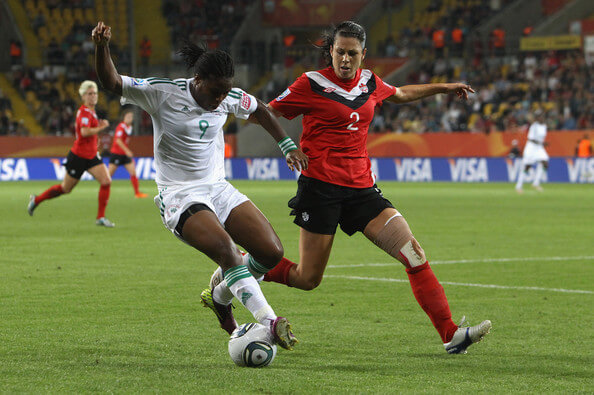 Emily Zurrer (R) of Canada and Desire Oparanozie (L) of Nigeria battle for the ball during the FIFA Women's World Cup 2011 Group A match between Canada and Nigeria at Rudolf-Harbig-Stadion on July 5, 2011 in Dresden, Germany.  (July 4, 2011 - Source: Martin Rose/Getty Images Europe)