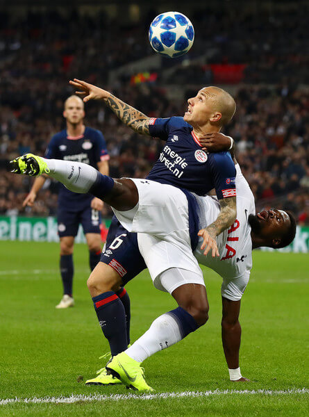 Serge Aurier of Tottenham Hotspur is challenged by Jose Tasende of PSV Eindhoven during the Group B match of the UEFA Champions League between Tottenham Hotspur and PSV at Wembley Stadium on November 6, 2018 in London, United Kingdom.  (Nov. 5, 2018 - Source: Clive Rose/Getty Images Europe)