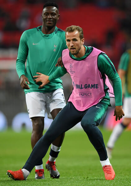 Victor Wanyama of Tottenham Hotspur and Harry Kane of Tottenham Hotspur warm up prior to the Group B match of the UEFA Champions League between Tottenham Hotspur and FC Barcelona at Wembley Stadium on October 3, 2018 in London, United Kingdom.  (Oct. 2, 2018 - Source: Shaun Botterill/Getty Images Europe)
