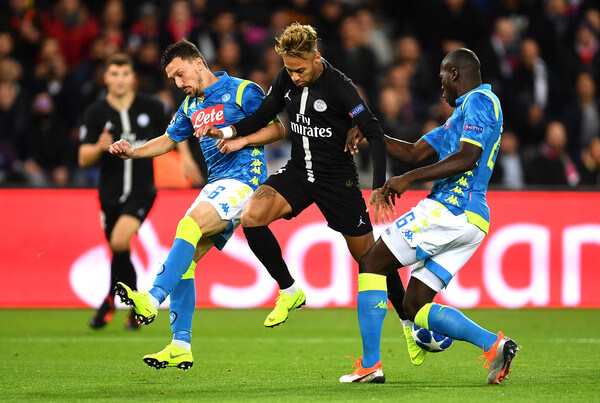 Neymar of Paris Saint-Germain is challenged by Mario Rui and Kalidou Koulibaly of Napoli during the Group C match of the UEFA Champions League between Paris Saint-Germain and SSC Napoli at Parc des Princes on October 24, 2018 in Paris, France.  (Oct. 23, 2018 - Source: Justin Setterfield/Getty Images Europe)