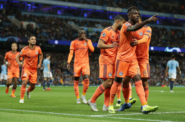 Maxwell Cornet of Lyon celebrates after scoring his team's first goal with his team mates during the Group F match of the UEFA Champions League between Manchester City and Olympique Lyonnais at Etihad Stadium on September 19, 2018 in Manchester, United Kingdom.  (Sept. 18, 2018 - Source: Richard Heathcote/Getty Images Europe)