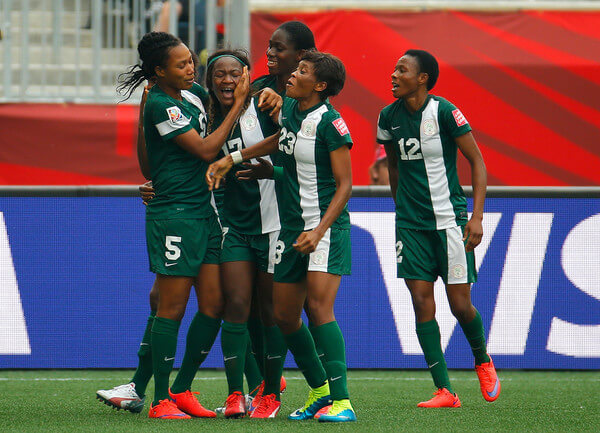 Francisca Ordega #17 of Nigeria celebrates her game-tying goal against Sweden with Onome Ebi #5, Asisat Oshoala #8 and Ngozi Ebere #23 during the FIFA Women's World Cup Canada 2015 Group D match between Sweden and Nigeria at Winnipeg Stadium on June 8, 2015 in Winnipeg, Canada.  (June 7, 2015 - Source: Kevin C. Cox/Getty Images North America)