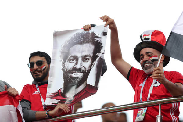 Egypt fans hold a poster of Mohamed Salah prior to the 2018 FIFA World Cup Russia group A match between Egypt and Uruguay at Ekaterinburg Arena on June 15, 2018 in Yekaterinburg, Russia.  (June 14, 2018 - Source: Clive Rose/Getty Images Europe)
