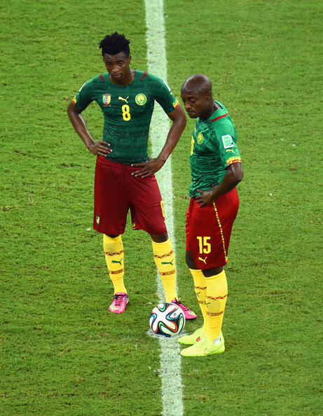 Benjamin Moukandjo and Pierre Webo of Cameroon wait to kick off after a goal during the 2014 FIFA World Cup Brazil Group A match between Cameroon and Croatia at Arena Amazonia on June 18, 2014 in Manaus, Brazil.  (June 17, 2014 - Source: Stu Forster/Getty Images South America)