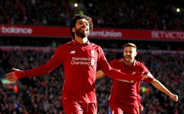 Mohamed Salah of Liverpool celebrates after scoring his team's first goal during the Premier League match between Liverpool FC and Cardiff City at Anfield on October 27, 2018 in Liverpool, United Kingdom.  (Oct. 26, 2018 - Source: Jan Kruger/Getty Images Europe)