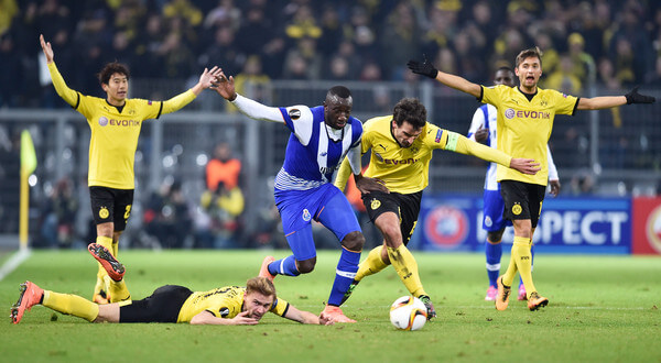 Moussa Marega of FC Porto and Mats Hummels of Borussia Dortmund compete for the ball during the UEFA Europa League round of 32 first leg match between Borussia Dortmund and FC Porto at Signal Iduna Park on February 18, 2016 in Dortmund, Germany.  (Feb. 17, 2016 - Source: Dennis Grombkowski/Bongarts)
