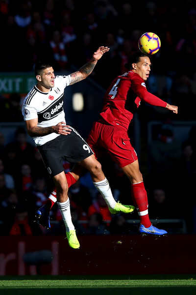 Aleksandar Mitrovic of Fulham battles for possession with Virgil van Dijk of Liverpool during the Premier League match between Liverpool FC and Fulham FC at Anfield on November 11, 2018 in Liverpool, United Kingdom.  (Nov. 10, 2018 - Source: Alex Livesey/Getty Images Europe)