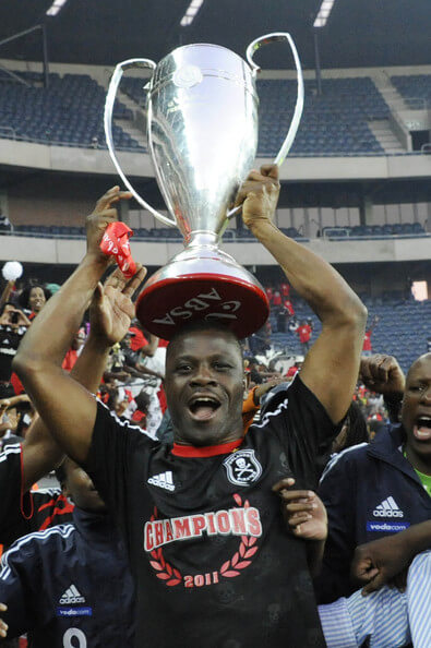 Orlando Pirates captain Lucky Lekgwathi holds aloft the premiership trophy after winning the Absa Premiership Final match between Orlando Pirates and the Golden Arrows at Orlando Stadium on May 21, 2011 in Soweto, South Africa.  (May 20, 2011 - Source: Gallo Images/Getty Images Europe)