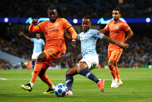 Raheem Sterling of Manchester City shoots while under pressure from Tanguy NDombele Alvaro of Lyon during the Group F match of the UEFA Champions League between Manchester City and Olympique Lyonnais at Etihad Stadium on September 19, 2018 in Manchester, United Kingdom.  (Sept. 18, 2018 - Source: Julian Finney/Getty Images Europe)