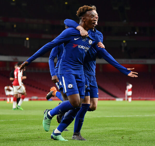 Callum Hudson-Odoi of Chelsea celebrates his second goal, Chelsea's fourth, with team mates during the FA Youth Cup Final second leg between Chelsea and Arsenal at Emirates Stadium on April 30, 2018 in London, England.  (April 29, 2018 - Source: Justin Setterfield/Getty Images Europe)