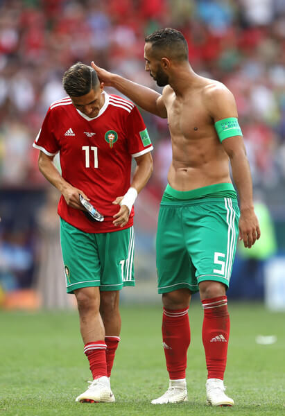 Faycal Fajr (L) of Morocco is consoled by Mehdi Benatia following his sides defeat, meaning his team are knocked out of the World Cup after the 2018 FIFA World Cup Russia group B match between Portugal and Morocco at Luzhniki Stadium on June 20, 2018 in Moscow, Russia.  (June 19, 2018 - Source: Michael Steele/Getty Images Europe